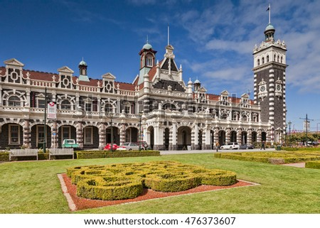 Dunedin, New Zealand: 19 March 2012 - Dunedin Railway Station, now only used by the Taieri Gorge preservation railway, seen across the gardens in Anzac Square.