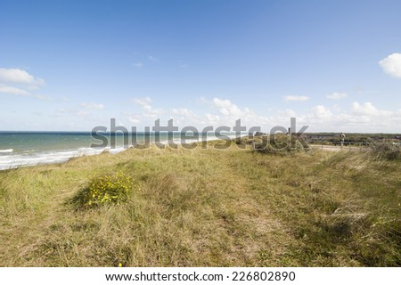 Dunes along the coastline in Domburg of Zeeland in the Netherlands - stock photo