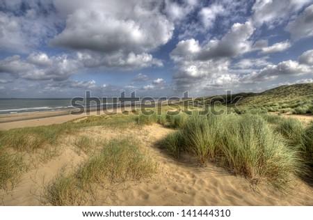 Dunes and beach along the Dutch coast near The Hague, Holland - stock photo