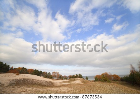 Dunes and sky. - stock photo