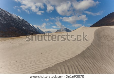 Dunes in the hills on the site of a mountain river - stock photo