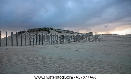 Dunes, sea, clouds and fences