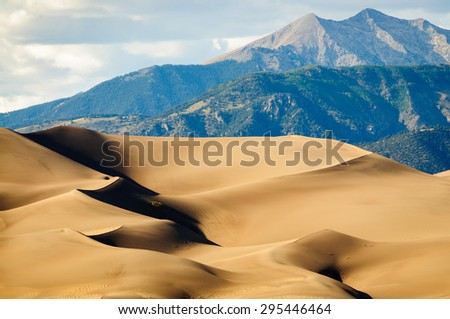 Dunes with Mountain at Great Sand Dunes National Park - stock photo