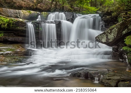 Dunloup Falls on Dunloup Creek is an exceptionally beautiful West Virginia waterfall about two miles from the New River and the old railroad town of Thurmond. - stock photo