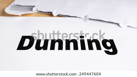 dunning letter with opened envelope on desk - stock photo