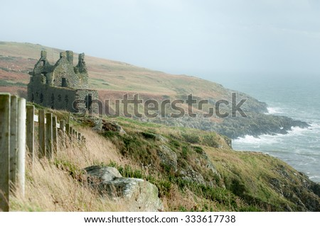 Dunskey Castle ruin on the edge of the west coast of Scotland - stock photo