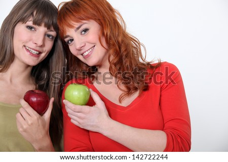 duo of girls with apples - stock photo