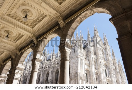 Duomo cathedral of Milan, Italy. look from the arcade portico.   - stock photo