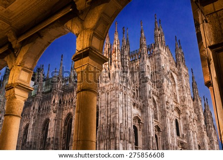 Duomo cathedral of Milan, Italy. look from the arcade portico. Night scene.  - stock photo
