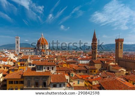 Duomo Santa Maria Del Fiore, Badia Fiorentina and Bargello at morning from Palazzo Vecchio in Florence, Tuscany, Italy - stock photo