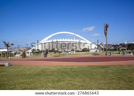 DURBAN, SOUTH AFRICA - DECEMBER 12, 2014: Grass verge and promenade in front of Moses Mabhida Stadium in Durban, South Africa