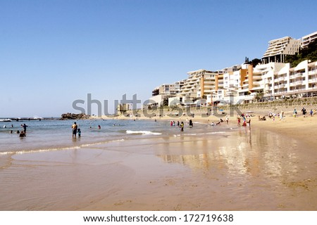 DURBAN, SOUTH AFRICA -  DECEMBER 12, 2013: Holiday makers on Umdloti beach  on December 12, 2013 in Durban, South Africa - stock photo