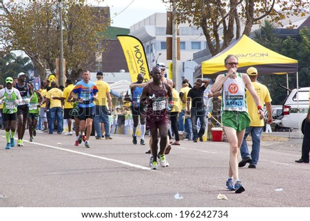 DURBAN, SOUTH AFRICA - JUNE 1, 2014: Eight unknown runners competing in the long distance Comrades Ultra Marathon between Pietermaritzburg and Durban in South Africa.