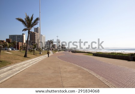 DURBAN, SOUTH AFRICA - JUNE 7, 2015: Many unknown people on beach front promenade in Durban, South Africa