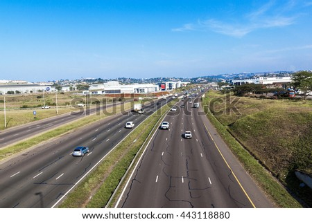DURBAN, SOUTH AFRICA - JUNE 24, 2016: Many vehicles head north and south at mid day on the N2 highway at Riverhorse Valley comercial district in Durban, South Africa