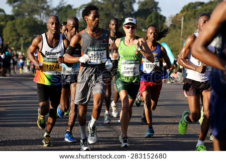 DURBAN, SOUTH AFRICA â?? MAY 31: Caroline Wostman wins the 2015 Comrades marathon up run for after winning the two Oceans marathon earlier this year in Kwa Zulu Natal, South Africa on May 31, 2015.  - stock photo