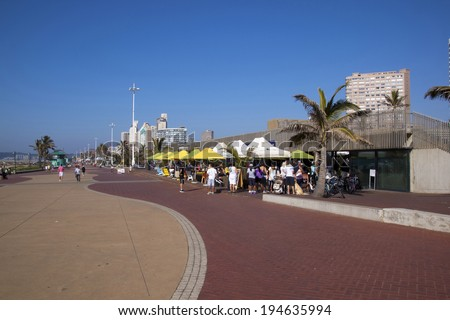 DURBAN, SOUTH AFRICA - MAY 24, 2014: Many people enjoy food and refreshments at promenade restaurant on Beachfront in Durban South Africa