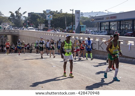 DURBAN, SOUTH AFRICA : MAY 29, 2016 : Many unknown spectators watch runners compete in the annual Comrades Marathon between Pietermaritzburg and Durban in South Africa