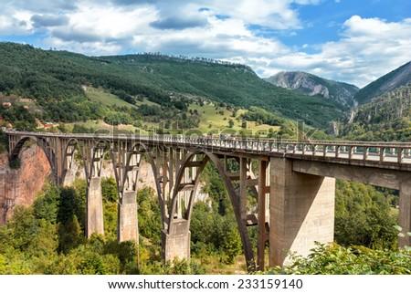 Durdevica Tara Bridge over the Tara River in northern Montenegro - stock photo