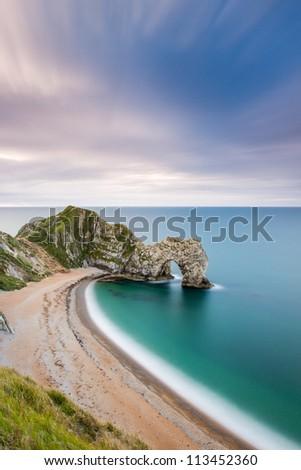 Durdle Door beach at first light, Dorset's Jurassic Coast - stock photo