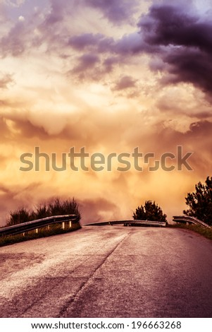 Dusk and moody road to nowhere. - stock photo