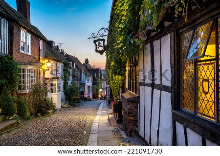 Dusk at a row of beautiful old houses on a cobbled street in Rye, East sussex - stock photo