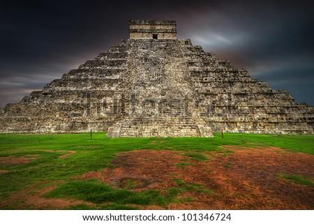Dusk coming at Kukulkan pyramid in Chichen Itza, Mexico - stock photo