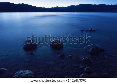 Dusk on the Bartogay lake in the Tien-Shan mountains,Kazakhstan - stock photo