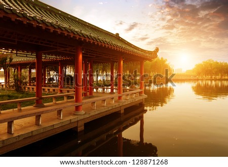 Dusk, pavilions on a river, Chinese architecture . - stock photo