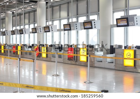 """Dusseldorf Airport, Dusseldorf, Germany:March 21, 2013. Lufthansa's counters with """"strike"""" sign at Dusseldorf airport.Lufthansa employees on strike. employees to work one hour more per week. - stock photo"""