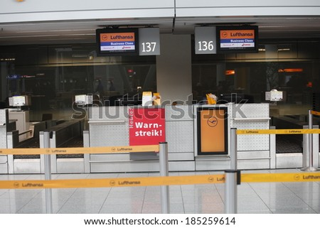 """Dusseldorf Airport, Dusseldorf, Germany: March 21, 2013. Lufthansa's counters with """"strike"""" sign at Dusseldorf airport.Lufthansa employees on strike.  - stock photo"""