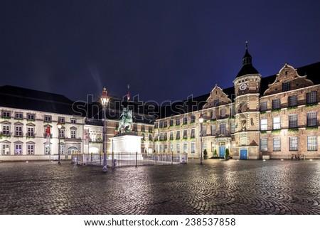 Dusseldorf city hall plaza with statue of Wilhelm - stock photo