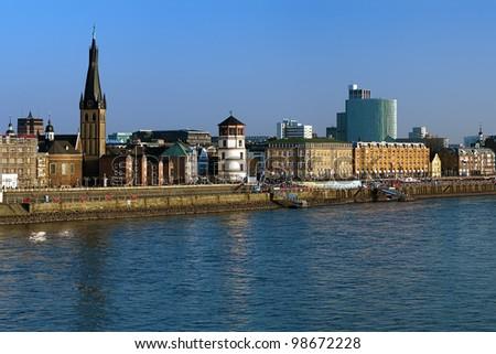 Dusseldorf, Embankment of the Rhine river with Basilica of St. Lambertus and Schlossturm, Germany - stock photo