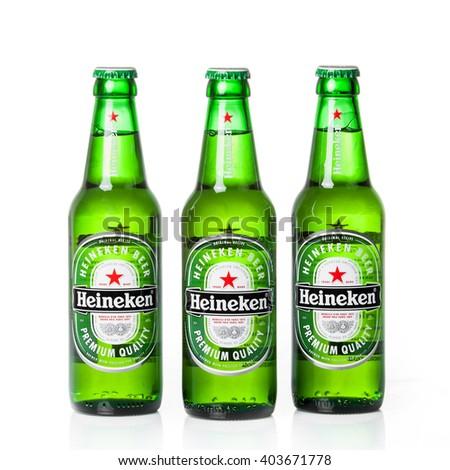 DUSSELDORF, GERMANY - APRIL 08, 2016:  Bottle of Heineken Lager Beer on white background. Heineken Lager Beer is a pale lager beer produced by the Dutch brewing company Heineken International - stock photo