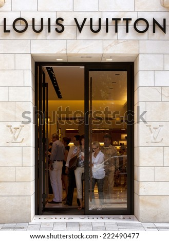 Dusseldorf, Germany - August 20, 2011: Louis Vuitton store on Koenigsallee. Louis Vuitton Malletier is a french fashion house founded in 1854, today belonging to LVMH group.