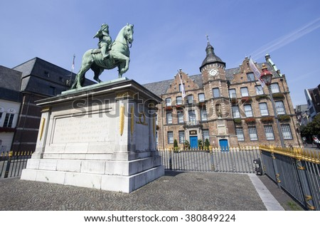 Dusseldorf, Germany - August 22, 2013: Marktplatz with the town hall (Rathaus) and statue of Johan Wilhelm in Dusseldorf, Germany on  August 22, 2013. - stock photo