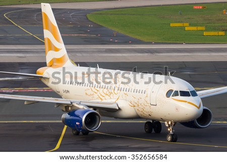 DUSSELDORF, GERMANY - DEC 17, 2015: British Airways Airbus A319 (Olympic Dove Livery) taxiing after landing at Dusseldorf airport. - stock photo
