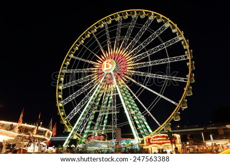 DUSSELDORF, GERMANY - JULY 21, 2013: A ferris wheel on the largest fair at the rhine river on July 21, 2013 in Dusseldorf. - stock photo