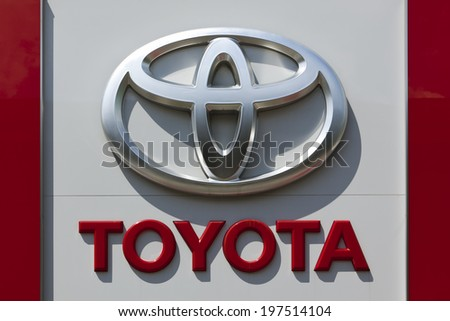 Dusseldorf, Germany - June 12, 2011: Toyota logo at a car retailer's building. Toyota Motor Co is world's largest automobile manufacturer by sales and production headquartered in Toyota, Japan.  - stock photo