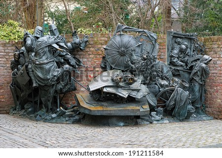 DUSSELDORF, GERMANY - MARCH 13, 2012: City Founding Monument (Stadterhebungsmonument) on Burgplatz square. The monument by German sculptor Bert Gerresheim was unveiled in 1988.