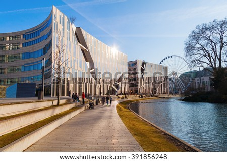DUSSELDORF, GERMANY - MARCH 15, 2016: Ko-Bogen with unidentified people. Ko-Bogen is a mixed used building, designed by New York architect Daniel Libeskind. - stock photo