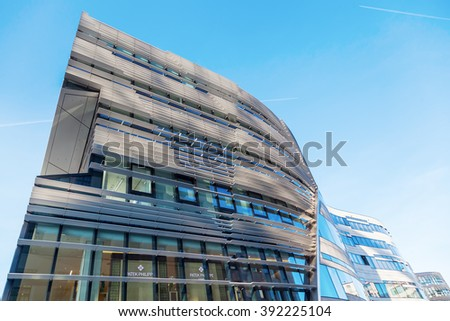 DUSSELDORF, GERMANY - MARCH 15, 2016: Ko-Bogen with unidentified people. Ko-Bogen is a mixed used building, designed by New York architect Daniel Libeskind.