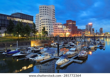 DUSSELDORF, GERMANY - MAY 28, 2015: Evening view of Media Harbor with buildings of Neuer Zollhof. The Neuer Zollhof buildings was designed by American architect Frank O. Gehry and completed in 1998. - stock photo