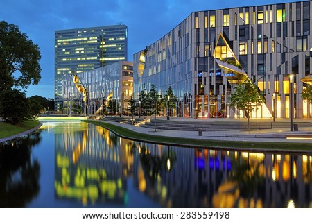 DUSSELDORF, GERMANY - MAY 19, 2015: Evening view of the Ko-Bogen. The Ko-Bogen is a large-scale office and retail complex designed by the New York architect Daniel Libeskind and completed in 2013. - stock photo