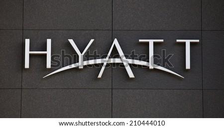 DUSSELDORF, GERMANY - MAY, 2014: Hyatt Hotels brandmark on modern facade. - stock photo