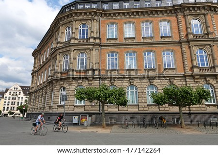 DUSSELDORF, GERMANY - MAY 26: Tourists cycling around the building on street near the Rhine river on May 26, 2011 in Dusseldorf, Germany. The Embankment of Rhine river in Dusseldorf historic center