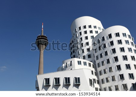 DUSSELDORF, GERMANY - SEPT 4: View of the Neuer Zollhof, designed by the architect Frank O. Gehry and completed in 1998, in the Media Harbor in Dusseldorf, Germany on September 04, 2013