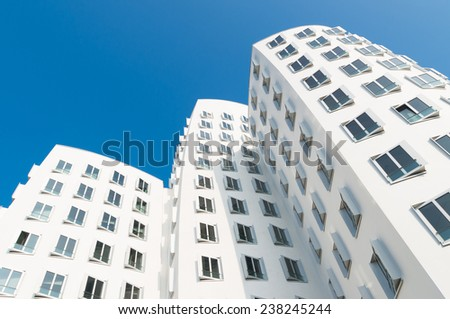 DUSSELDORF, GERMANY - SEPTEMBER 6, 2014: Modern distorted buildings of architect Frank O. Gehry located in the media harbor in dusseldorf - stock photo