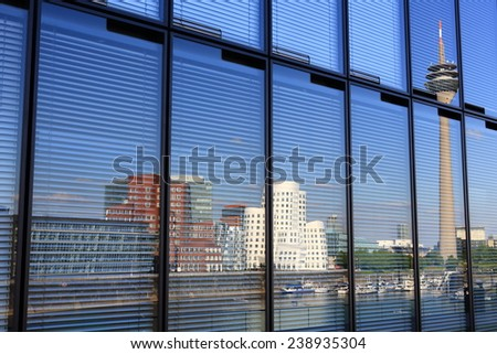 Dusseldorf media harbor panorama reflection in a glass facade - stock photo