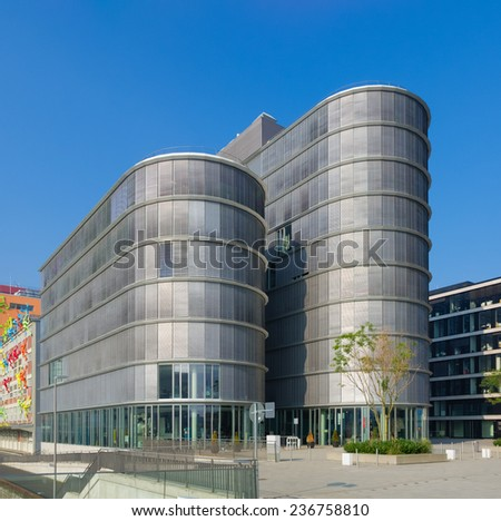 DUSSELDORF - SEPTEMBER 6, 2014: Modern office building in the media harbor.The Hafen district contains some spectacular post-modern architecture, but also some bars, restaurants and pubs. - stock photo